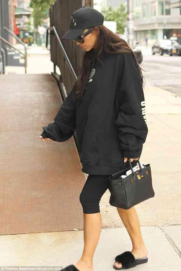 222e44fb0505 Kim Kardashian wearing Hermes Black Birkin Bag and Givenchy Mink Fur Slides