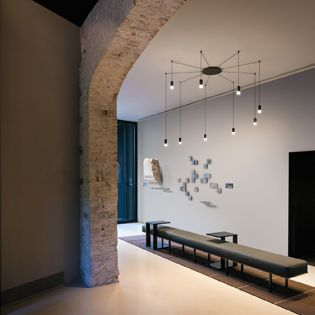 """WIREFLOW's electrical wire draws geometrical shapes in two or three-dimensions that, in spite of their large size, allow a see-through effect providing the light fixture with its captivating graphic essence. According to Levy, WIREFLOW combines """"presence and absence, transparency and luminosity, light and fluidity"""". http://www.vibia.com/en/lamps/show/id/03554/hanging_lamps_wireflow_0355_design_by_arik_levy.html"""