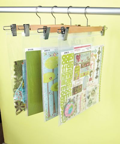 This is a great way to store scrapbook papers/pages....big ziplock bags hung on trouser hangers!