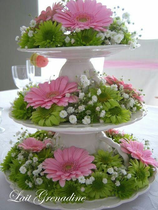 Using a cupcake stand as an arrangement piece flowers