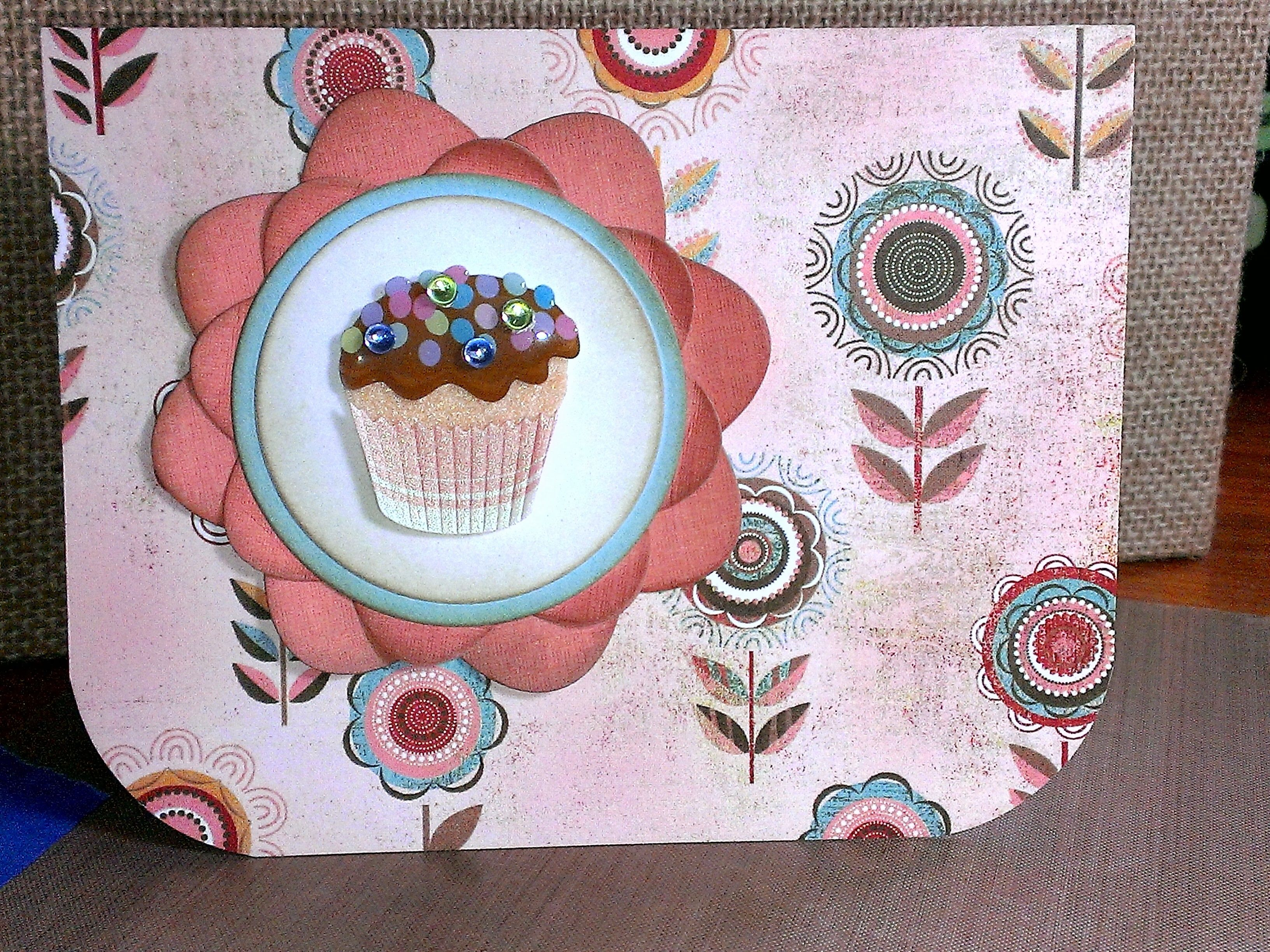 Jolee's Boutique 3D cupcake sticker, Sizzix Framelits dies, Frayed Burlap Distress Ink.  I've had this patterned paper soooo long, I can't remember where it came from.  The large rounded corners were made with Fiskars corner scissors (anyone else remember those?).