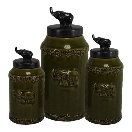 98abfee01 Three-piece ceramic canister set with elephant finials.