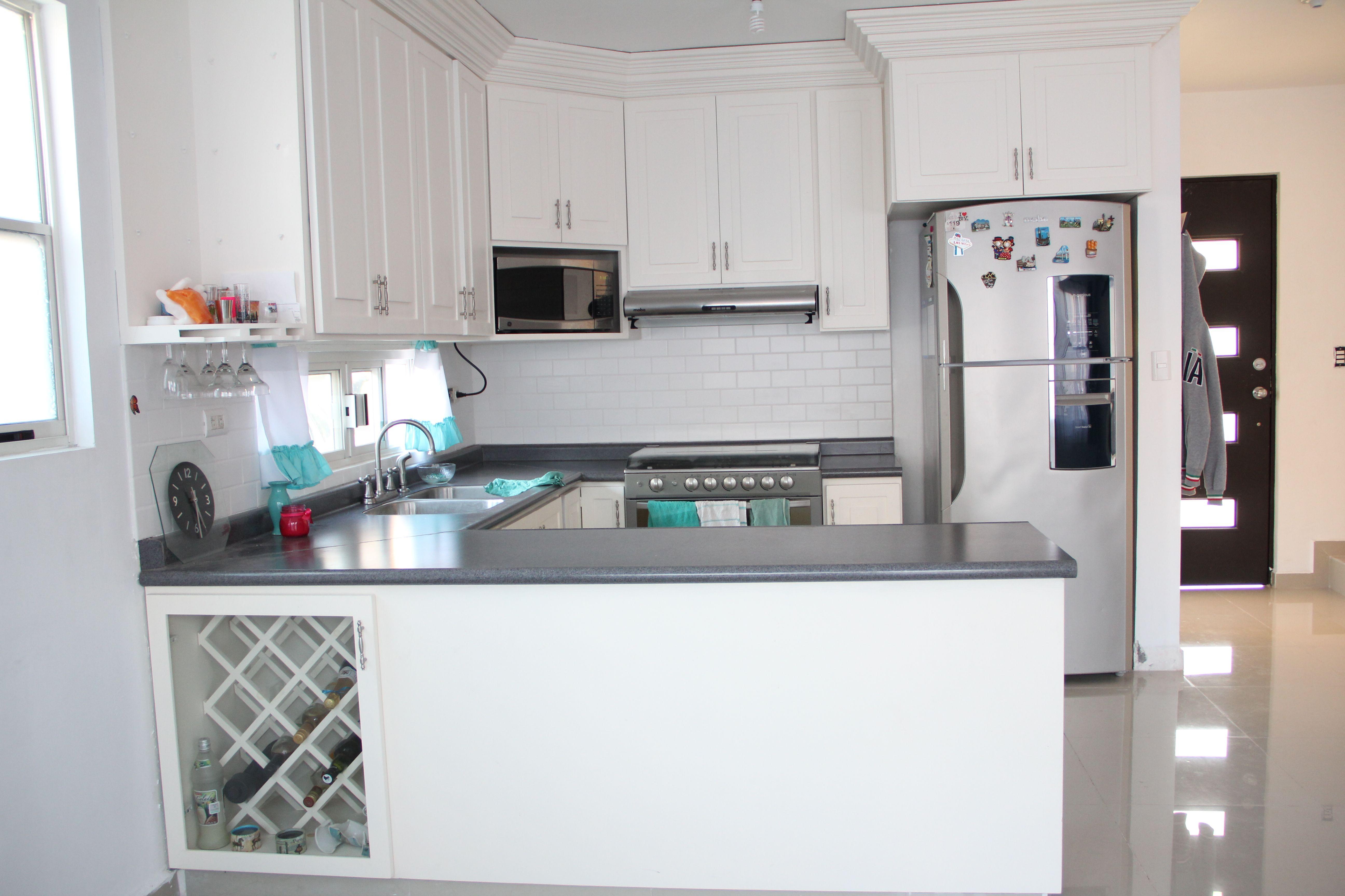 white traditional kitchen, long horizontal window, daltile white, a ...