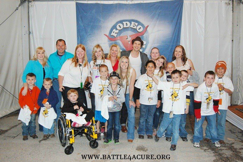 Singer Gavin DeGraw poses with young cancer patients and their families during a Meet & Greet set up by Gavin's crew for the Battle for a Cure Foundation in Austin, TX.