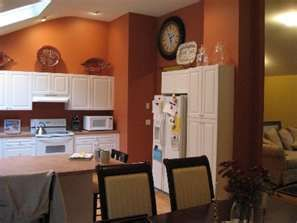 rust colored kitchen and white cabinets @mary telfer | decorating
