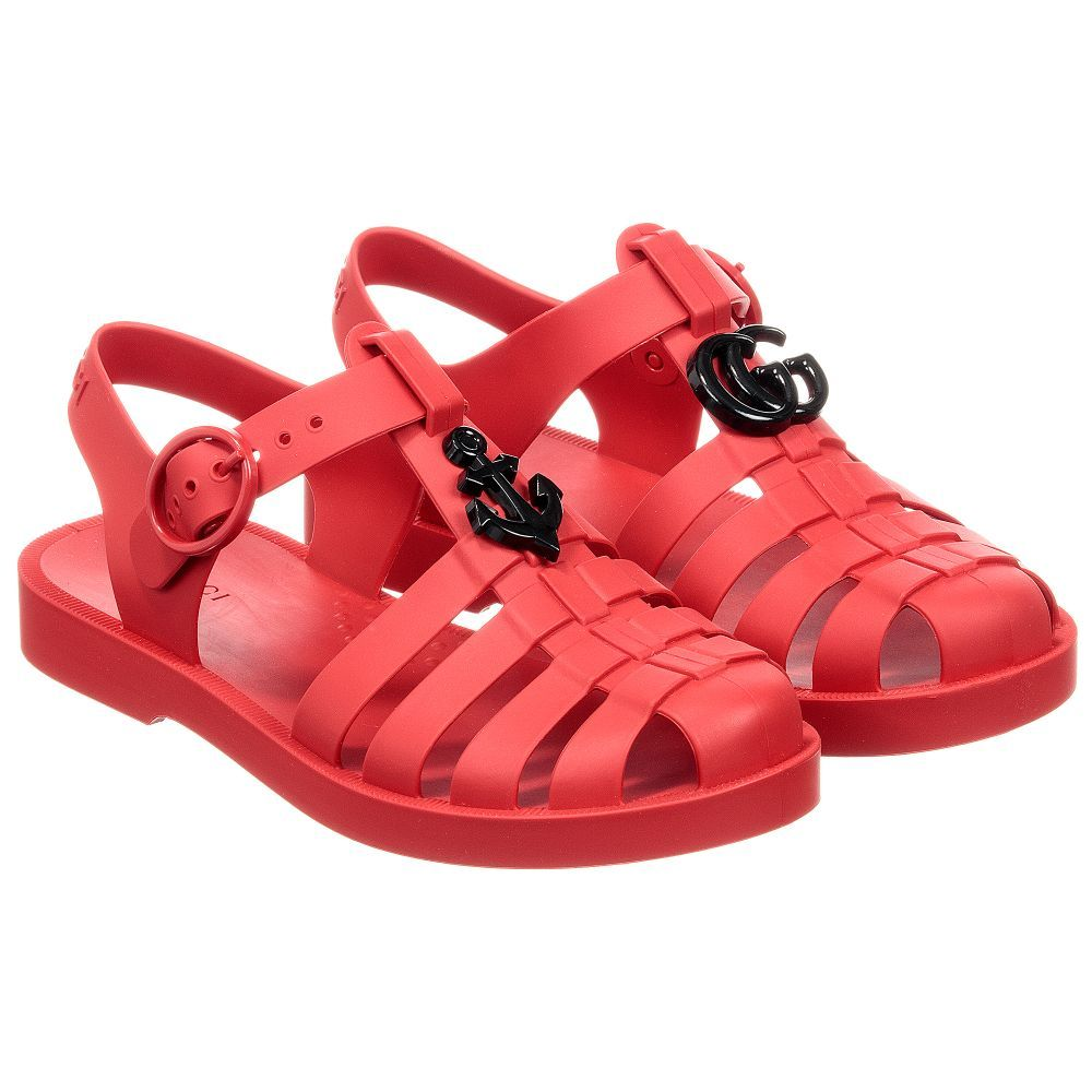 a63e9d8257c62 Gucci Red GG Rubber Sandals. Shop from an exclusive selection of designer  Shoes at Childrensalon.co.