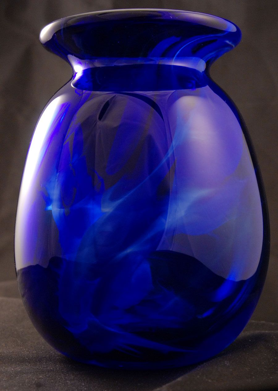 I love cobalt and this looks like the aurora borealis crazy for vases home decor cobalt blue swirly read more floridaeventfo Image collections