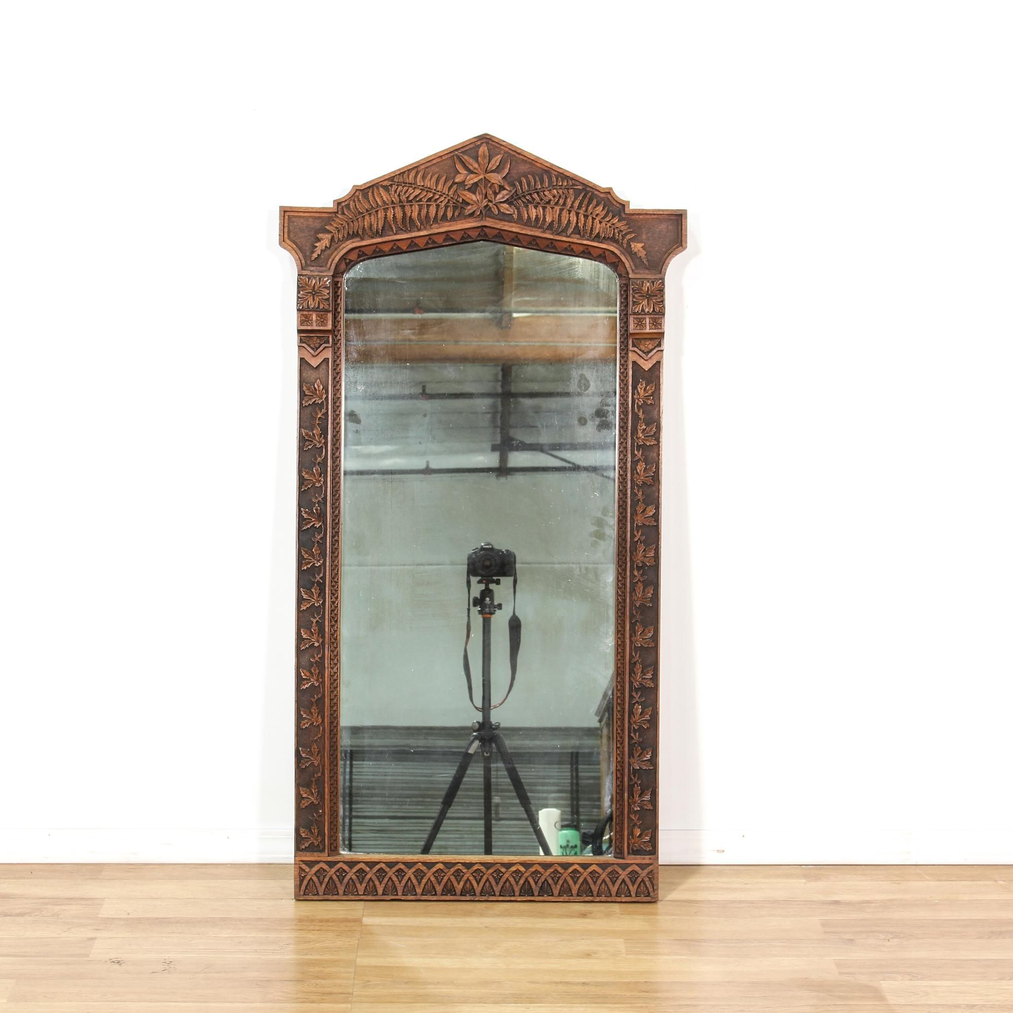 Hallway furniture with mirror  This accent mirror is featured in a solid wood with a rustic dark