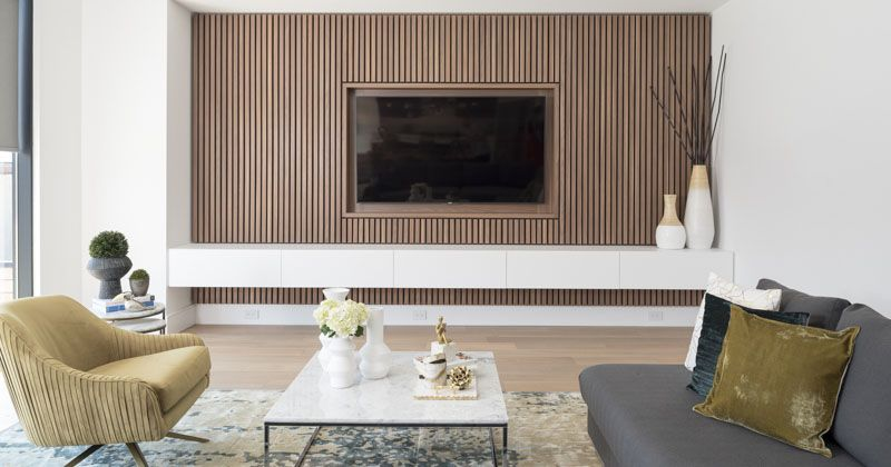 Design Detail A Wood Slat Accent Wall Surrounds The Tv In This Living Room In 2020 White Walls Living Room Living Room Tv Wall Contemporary Living Room