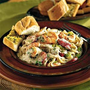 Scrumptious Shrimp Recipes | Cajun Shrimp and Andouille Alfredo Sauce Over Pasta  | MyRecipes