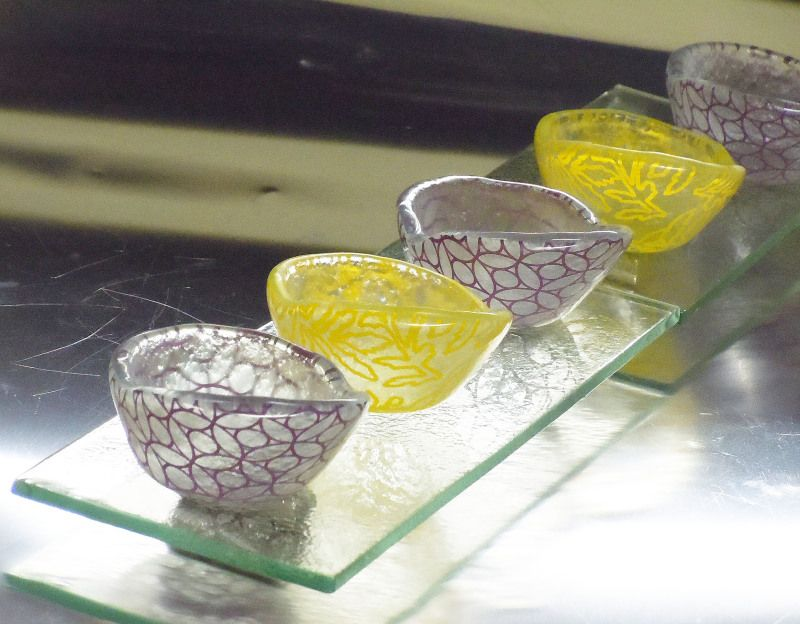 Small glass dessert cups set in yellow floral and purple arabesque design. By Glass Studio