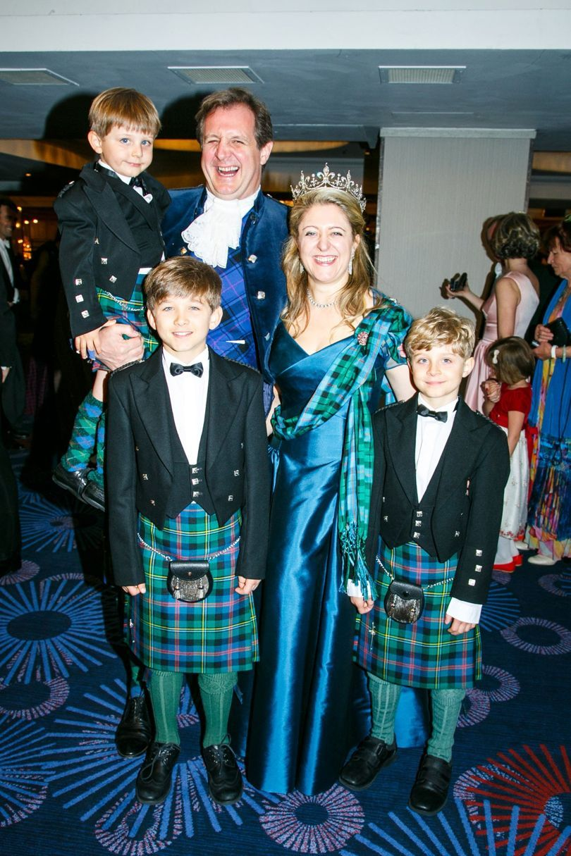 Felicia Morris, wearing a substantial diamond fleur de lys tiara, with husband, Houston and sons
