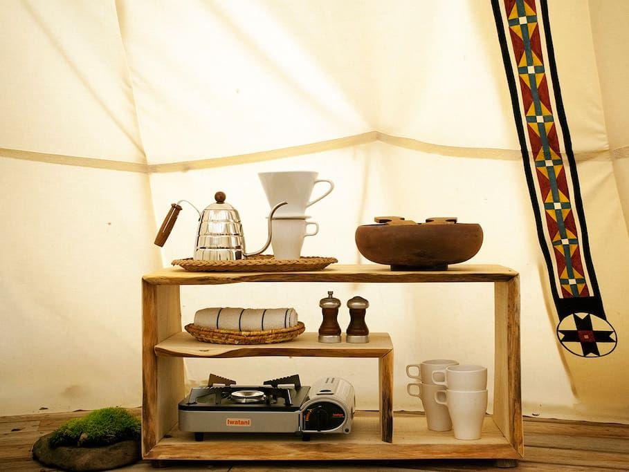 Kitchenette corner.  Kettle, coffee dripper, gas stove.
