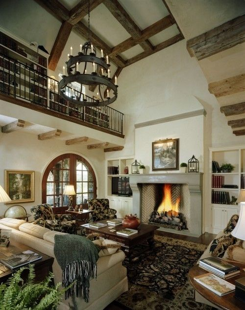 Cabin, Book Loft.  How cozy!! Love the rounded window. The fireplace. The seating. And - the loft filled with books!!