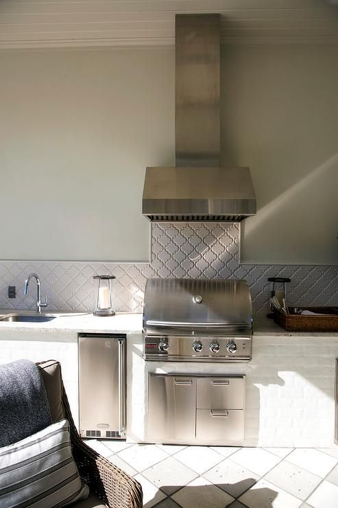 Beautiful Covered Patio Features A Stainless Steel Hood Mounted To A Light Gray Wall Above Home Depot Outdoor Kitchen Outdoor Bbq Kitchen White Tile Backsplash