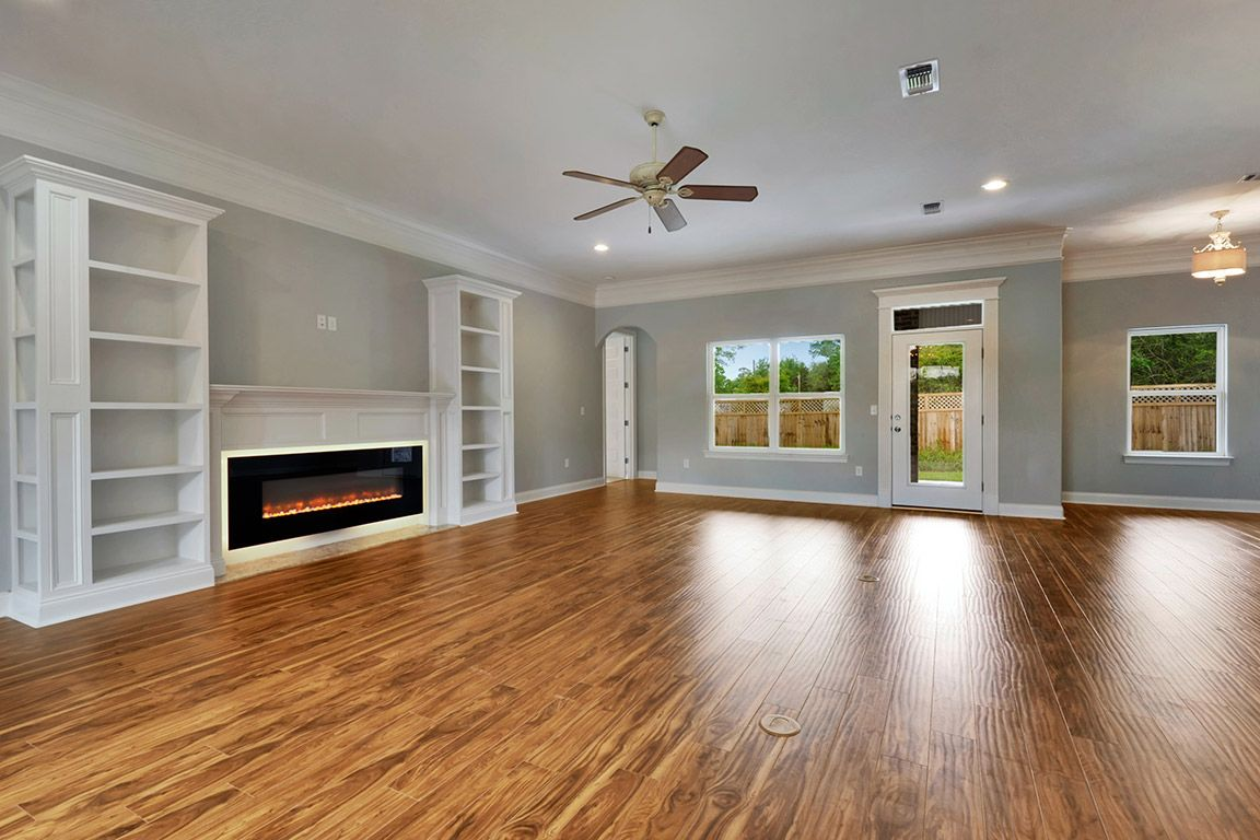 Open concept great room with electric fireplace and built ...