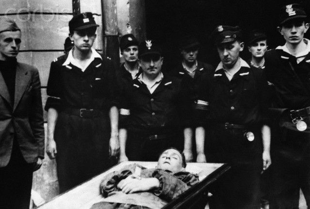 Polish soldiers with a comrade killed during the Warsaw Uprising of 1944.