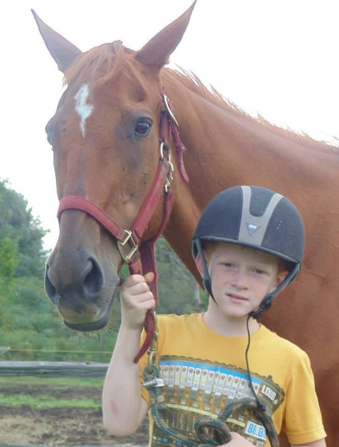 Brandon, 9, says he couldn't bear the thought of the ex-racehorse, whose looks reminded him of his own, going to slaughter. So after his mother explained to him that 17-year-old mare Karazan had been purchased by a meat buyer and would likely go to the slaughterhouse, he asked her to spend his birthday money to save her instead.