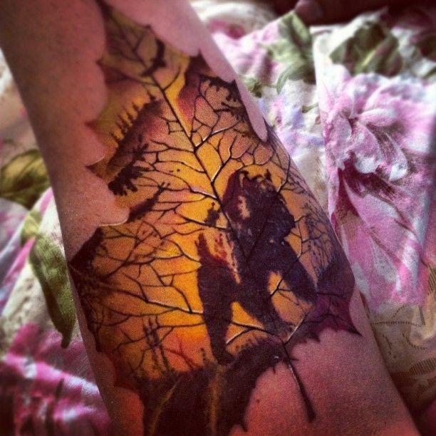 Maple Tree Tattoos: Awesome Silhouette Bear On A Maple Leaf Tattoo