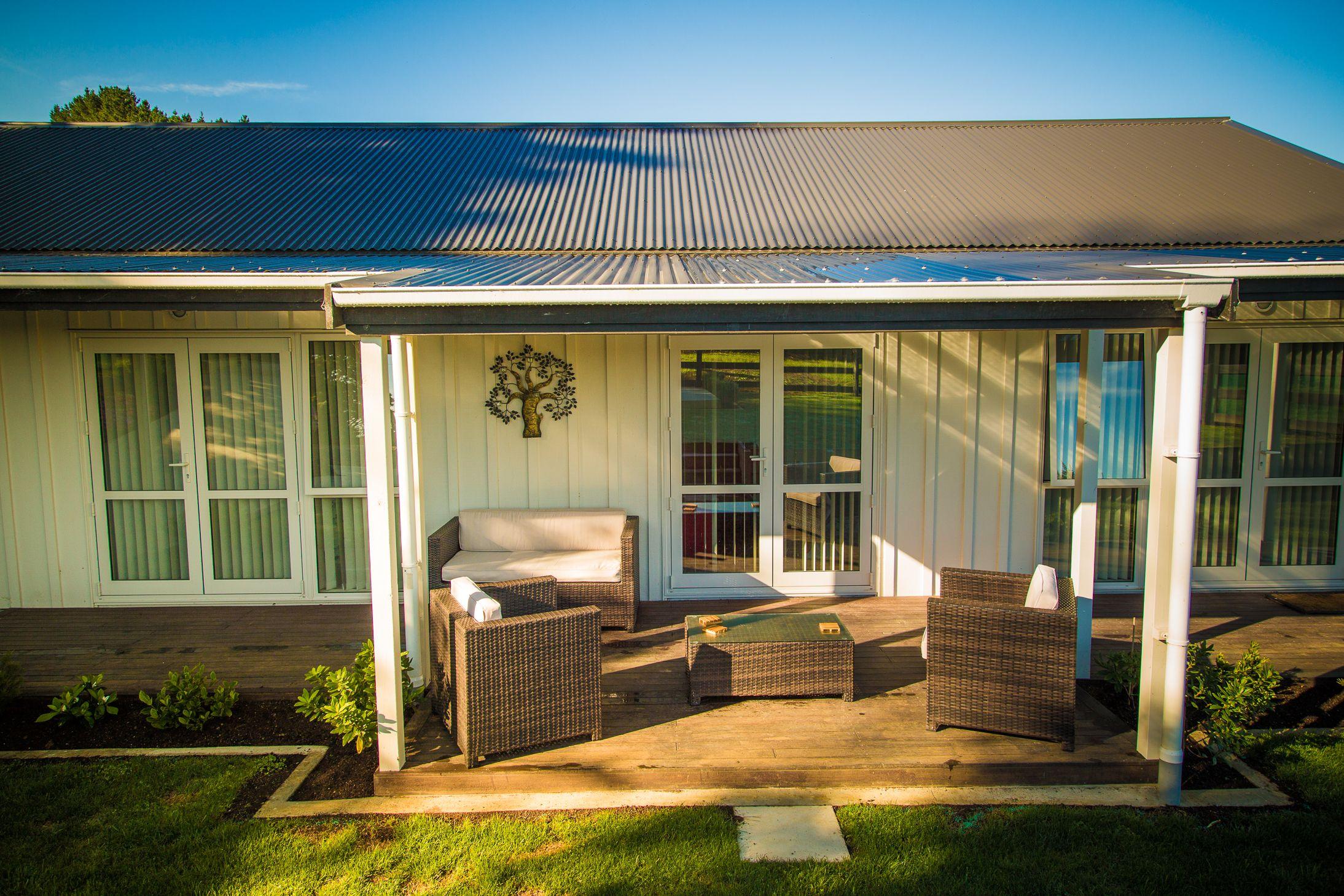 Covered verandah Barn style house, Timber frame building
