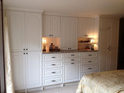 custom white wall unit in a master bedroom   wall units