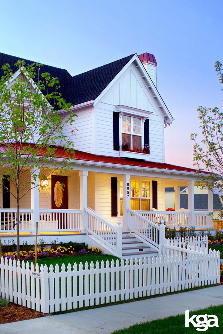 Traditional white victorian farmhouse with white picket fence. By KGA Studio Architects, PC.