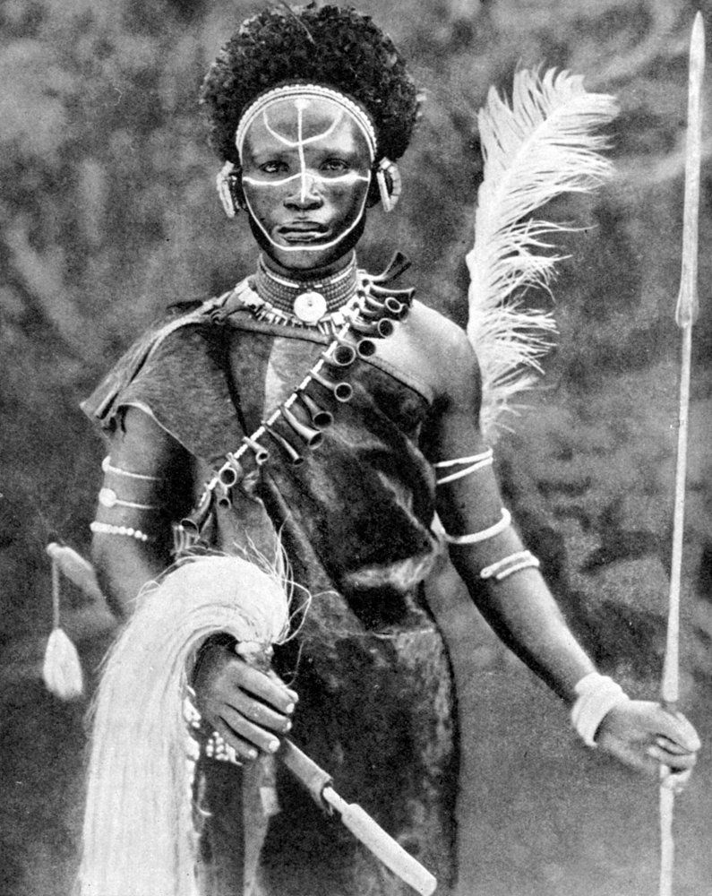 African man warrior with spear and traditional regalia