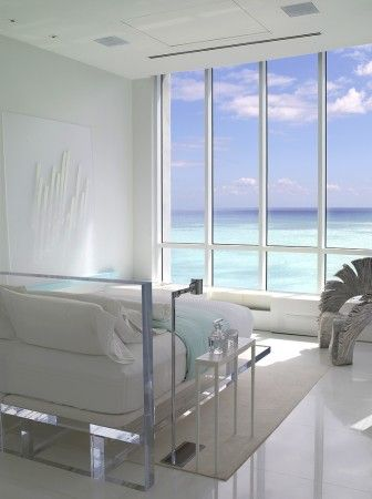 In a #Miami master #bedroom, #serenity, privacy and the creation of a zen-like atmosphere, be it morning or evening was the goal, along with a total ocean front experience. A custom lucite #bed floats in the space. #modern #decor #interiordesign #design #homedecor