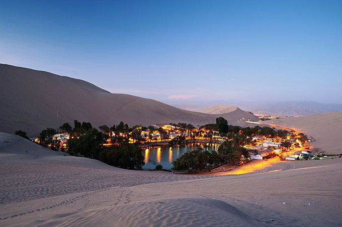 Huacachina, Peru - Peruvians desided it would be a good idea to build around the lake a real oasis in the desert. It attracts tourists hoping to catch a glimpse of the legendary mermaid said to inhabit the lake. www.MyWebTravelAgent.com