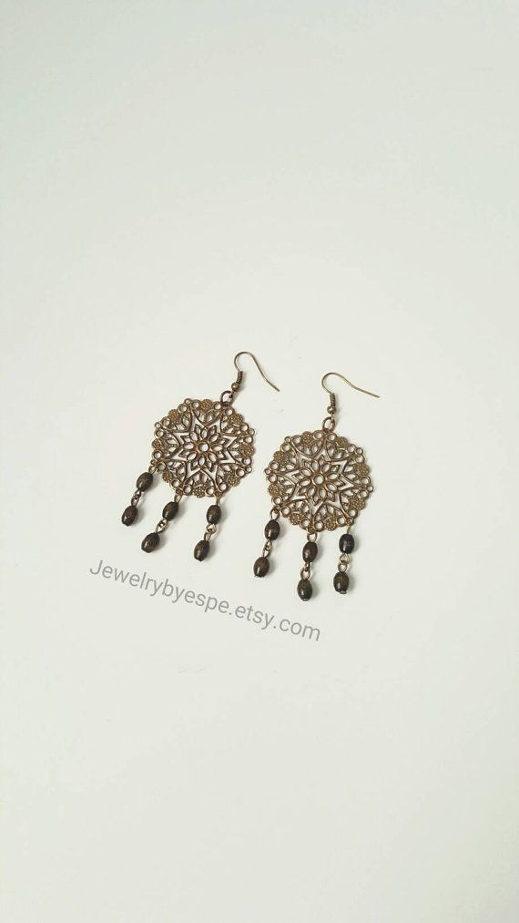 Hey, I found this really awesome Etsy listing at https://www.etsy.com/listing/484631726/brown-earrings-filigree-statement