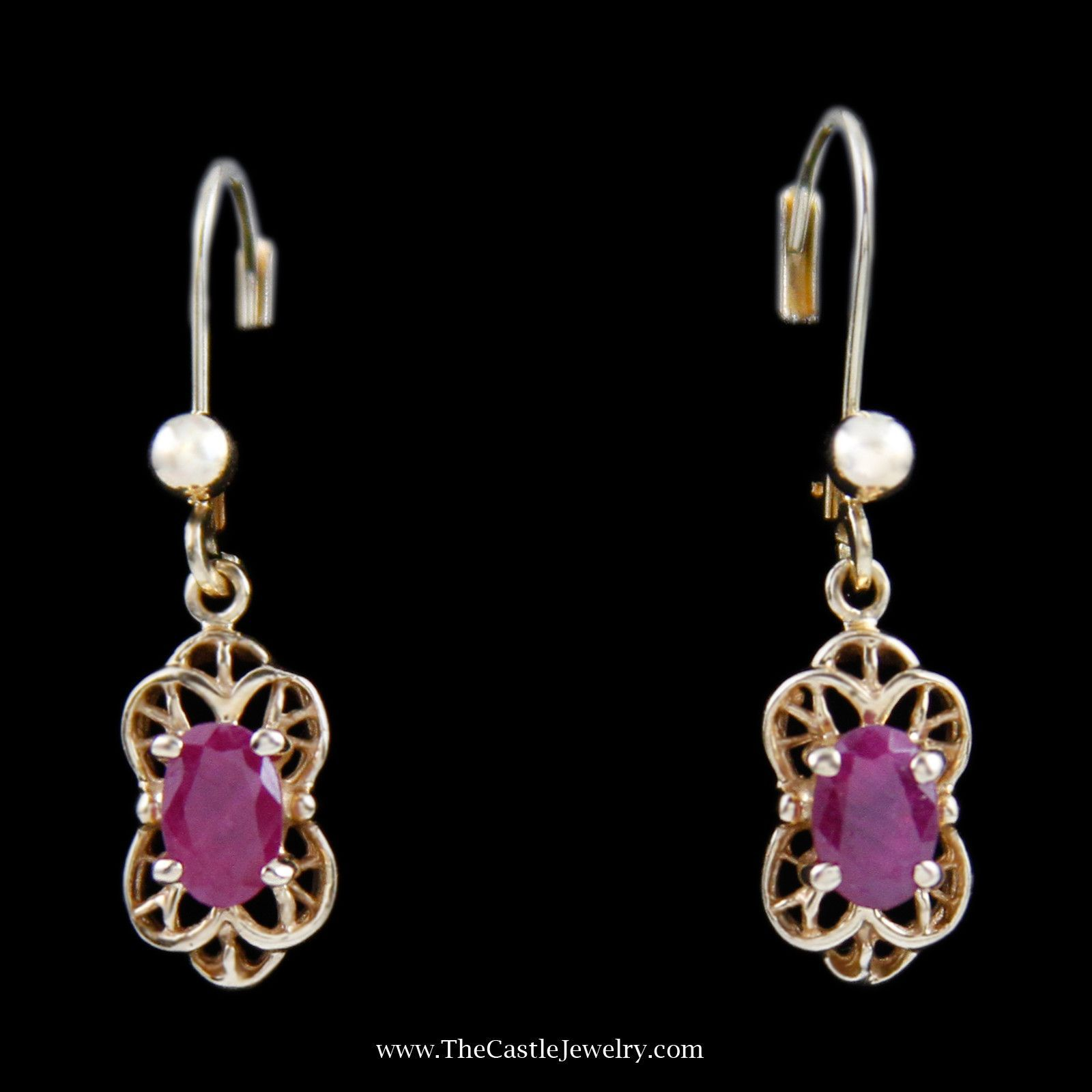 Charming Oval Ruby Earrings w/ Fancy Design Mounting in Yellow Gold