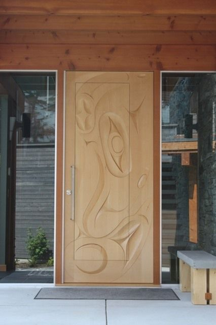 "Commissioned Door for a home. Is carved from Yellow Cedar and has the image of the Humpback whale (iit'uup.) Dimensions 96"" x 42"" x 2.25. Northwest coast art and First Nations Art at Ahtsik Native Art Gallery."
