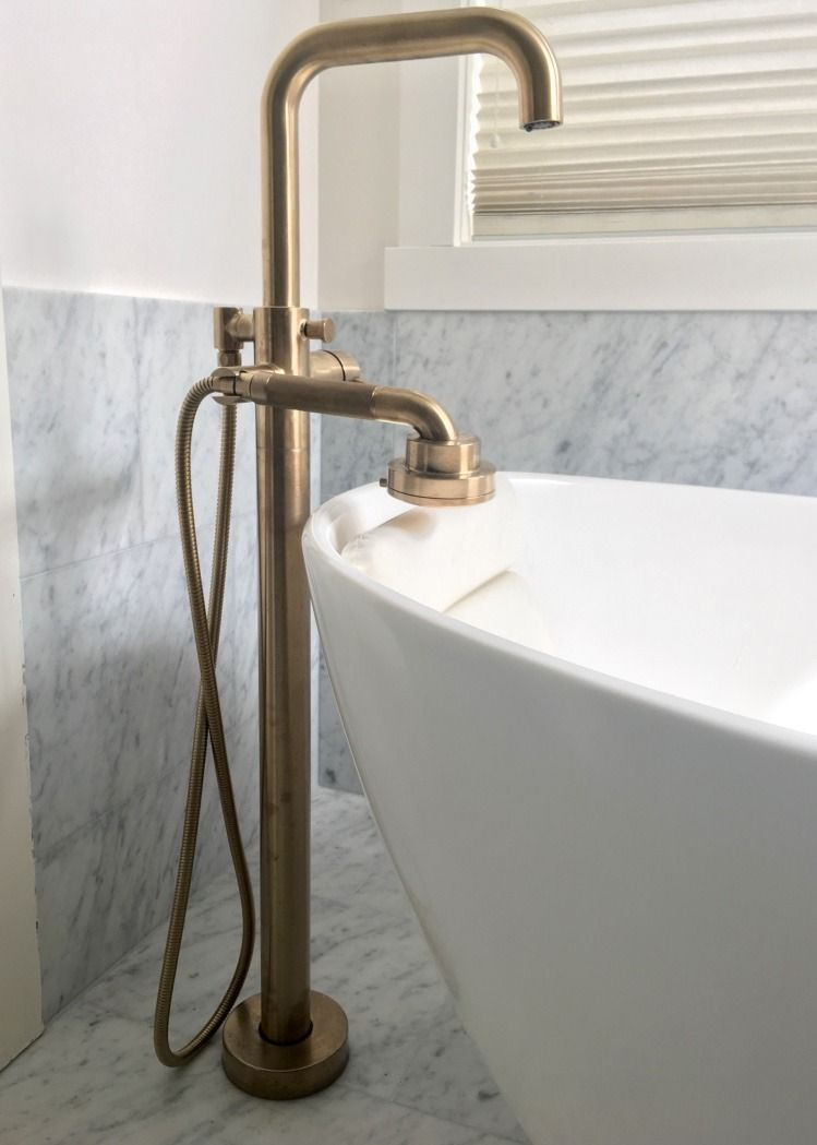 The Brizo Litze Lux Gold Widespread Faucet And Freestanding Tub Filler Give A Warm Tone Contrast To The Carrrara Mar Freestanding Tub Faucet Tub Faucet Faucet