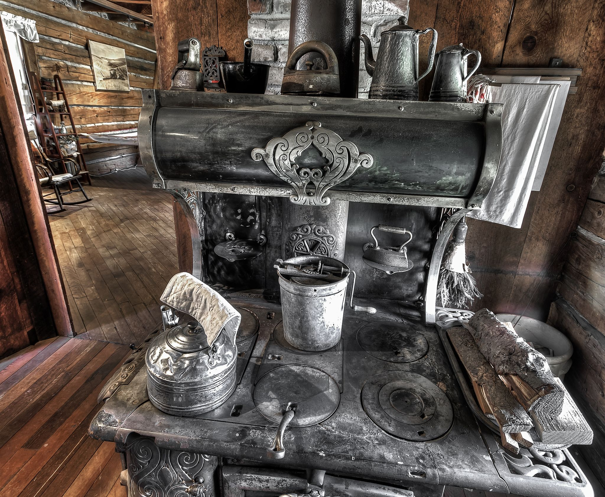 https://flic.kr/p/cTKxvy   Multi-purpose wood burning stove.   Heart of the kitchen in the Schreiber Log Cabin at the Dufur Historical Society Living History Museum on Main Street in Dufur, Oregon.