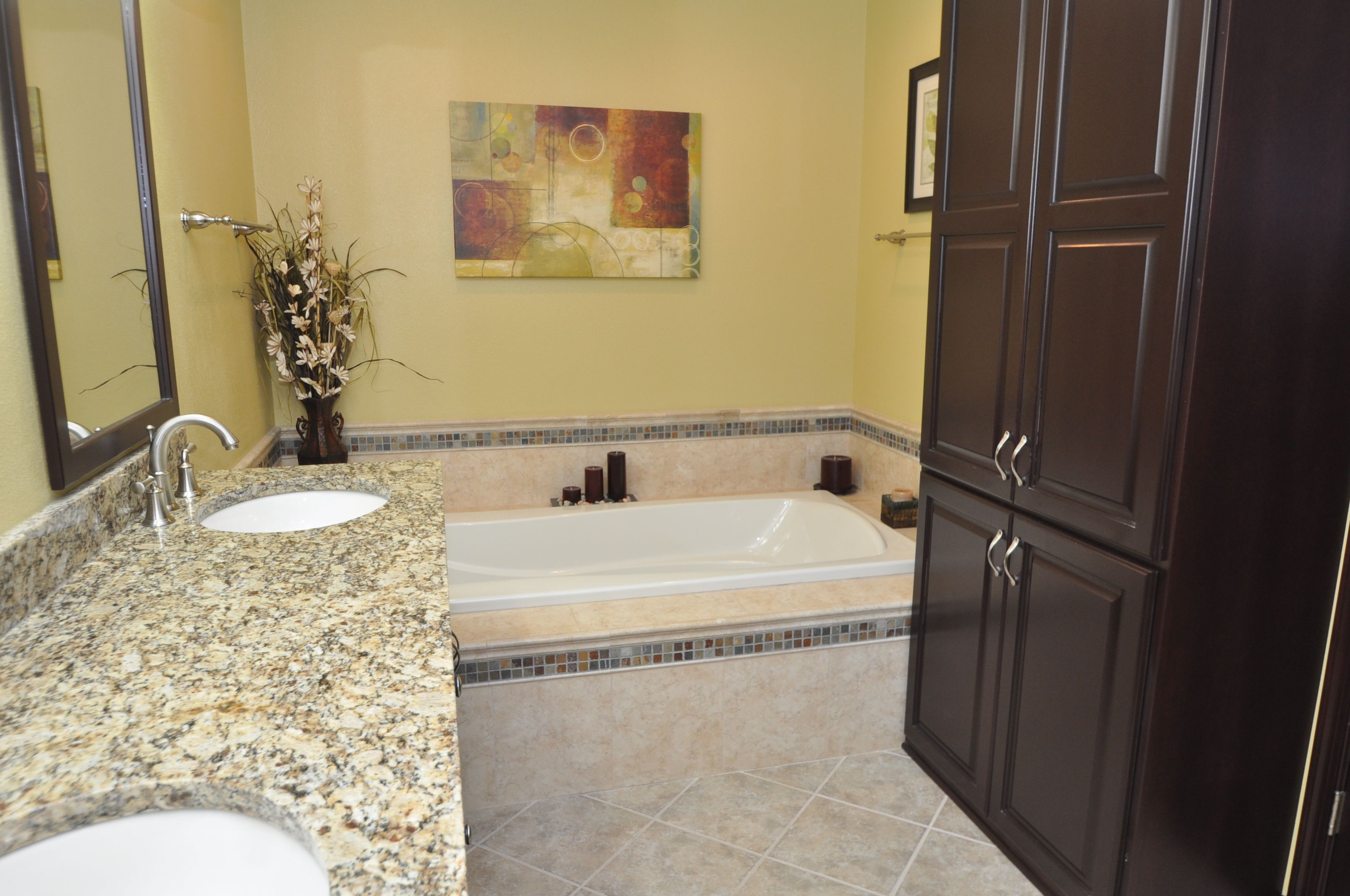 granite countertop, deep jetted tub in master bathroom, custom built vanity