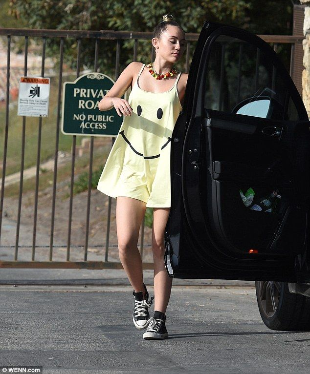 Miley Cyrus Heads To A Party In Neon Yellow Smiley Face Dress Miley Cyrus Style Miley Cyrus Miley