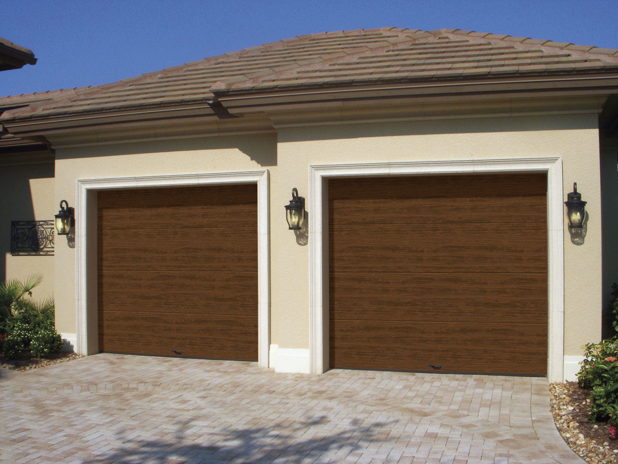 Clopay modern steel collection an insulated low for Flush panel wood garage door
