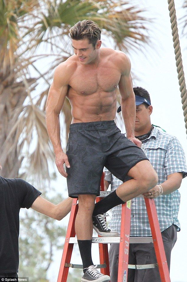 Zac efron flexes his muscles as he goes shirtless on baywatch set zac efron flexes his muscles as he goes shirtless on baywatch set dailymail thecheapjerseys Choice Image