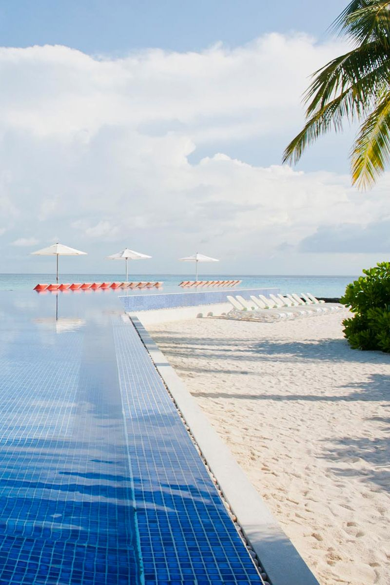 Stunning Infinity Pool At Kuramathi Island Resort With White