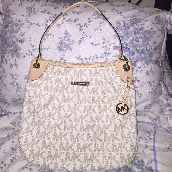 NEW Michael Kors Jet Set Tote Brand new without tags, comes with dustbag. Michael Kors Jet Set Signature Tote, scoop style. Bag height: 12in. Bag length: 9in. Bag width: 5 1/2in. Shoulder strap from bag to point: 9 1/2inq Michael Kors Bags Totes