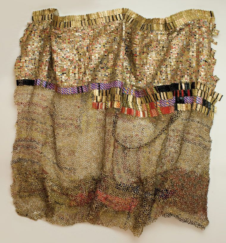El Anatsui - amazing - a photo will never do it justice after seeing the real thing- made out of recyled items such as bottle tops.