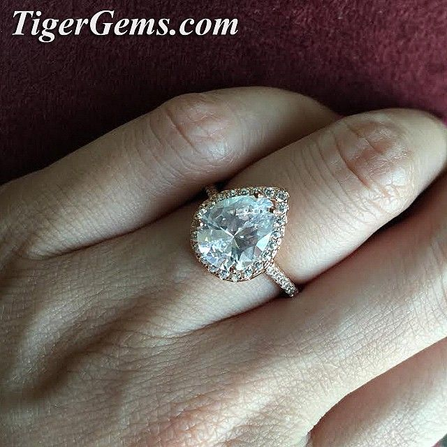 The 35 ct sterling silver halo ring plated in 14k rose gold Its