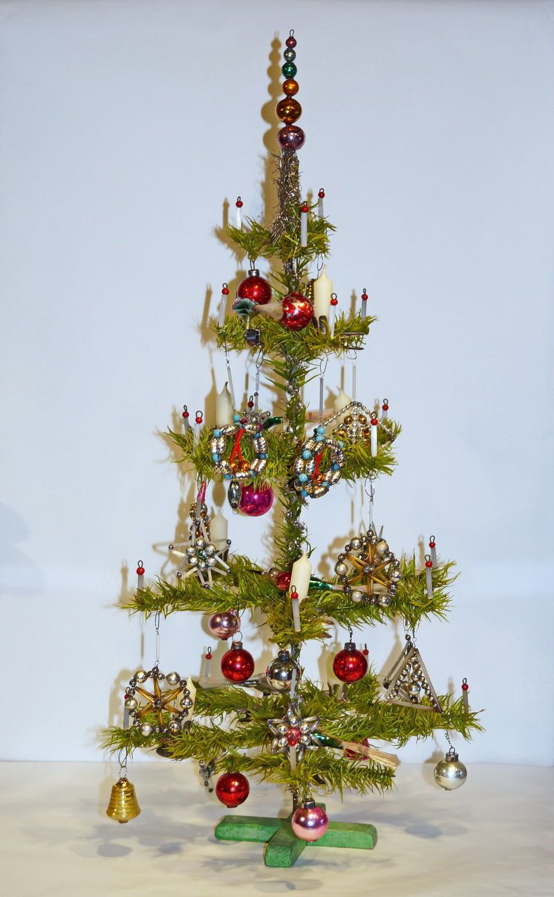 Antique German feather tree with antique glass ornaments, some beaded ornaments from czechoslakia.