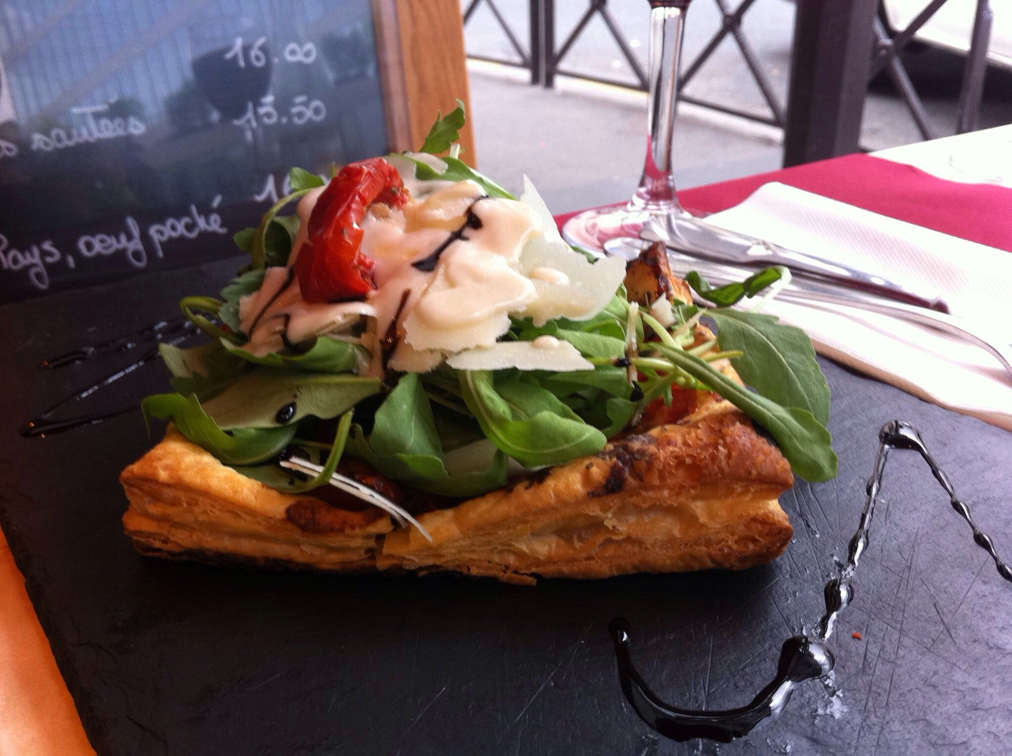 Tomato and Parmesan tart topped with aragula