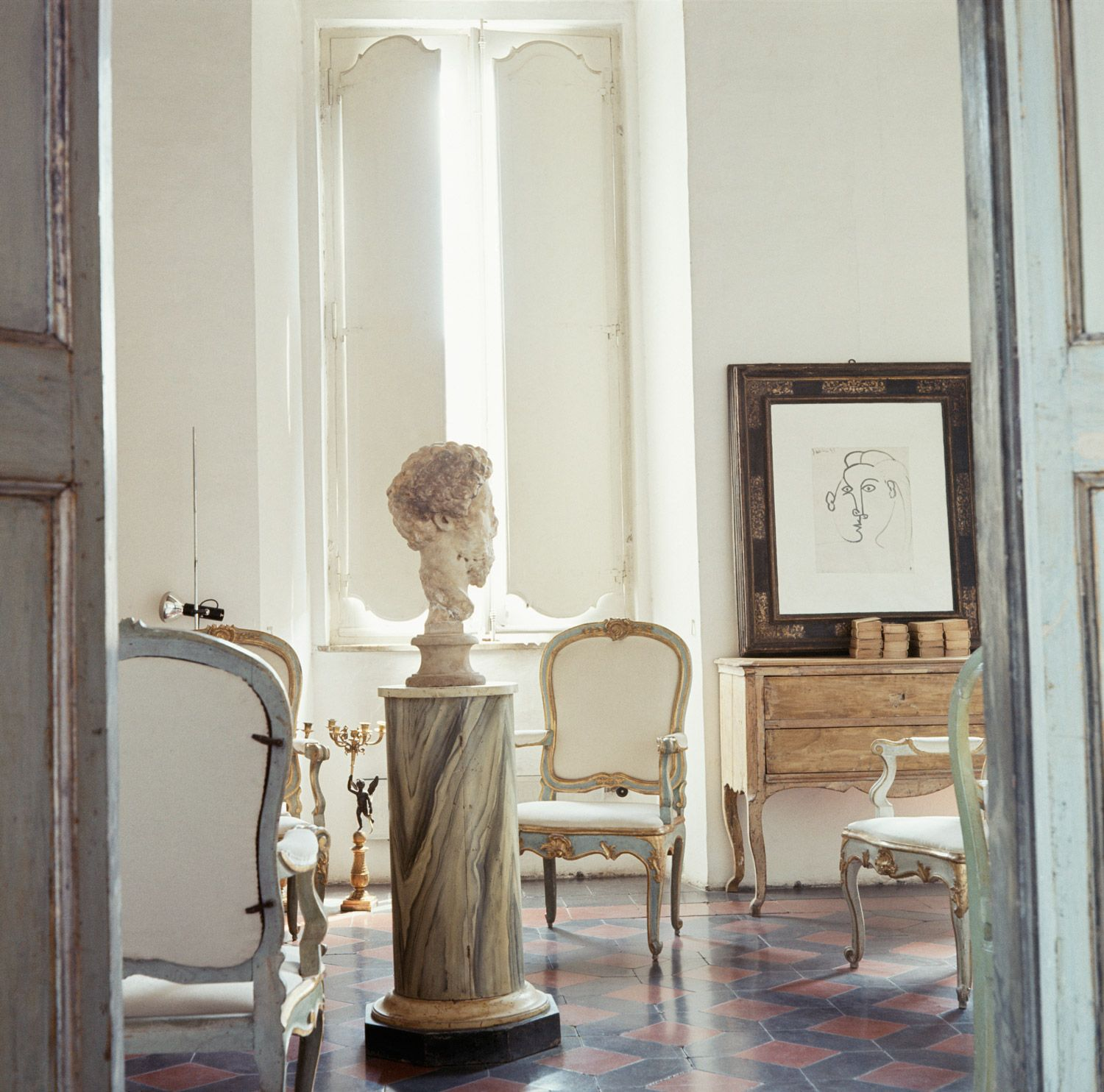 Cy Twombly's Italian home: In the drawing room, Picasso's Head Of A Woman (1943) faces down a bust of Marcus Aurelius.