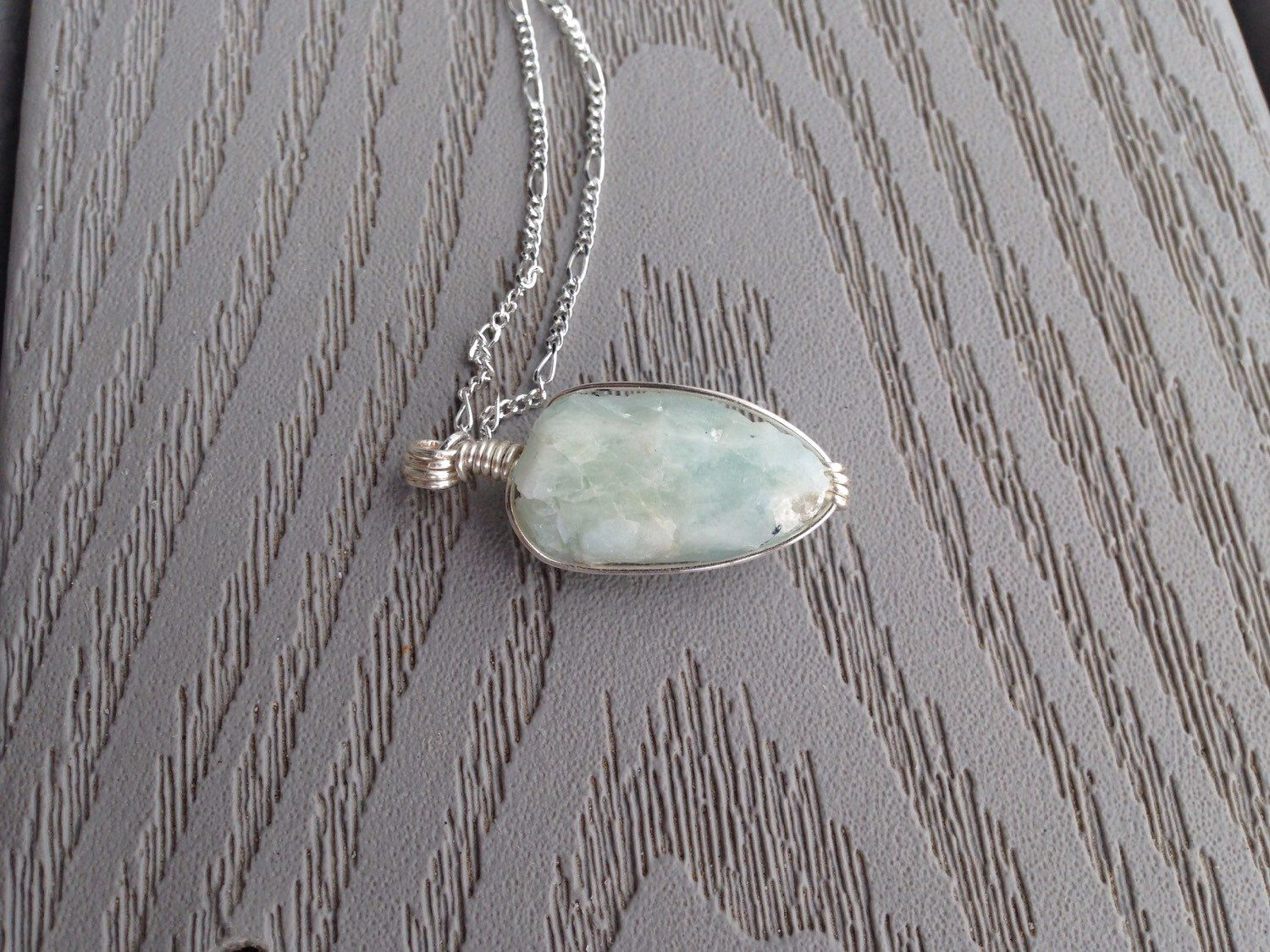 A personal favorite from my Etsy shop https://www.etsy.com/listing/221991243/reserved-tranquil-aquamarine-wire