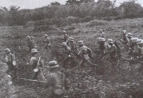 Chinese troops advance through field north of Shanghai during 1937 battle.