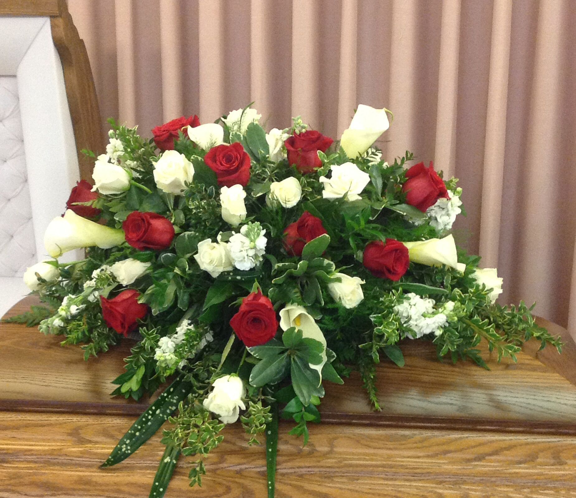 A casket with a natural feel, including thistles, cow ...  |Casket Flowers