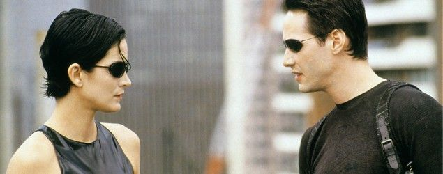 """Carrie-Anne Moss and Keanu Reeves in """"The Matrix."""" (Everett Collection)"""