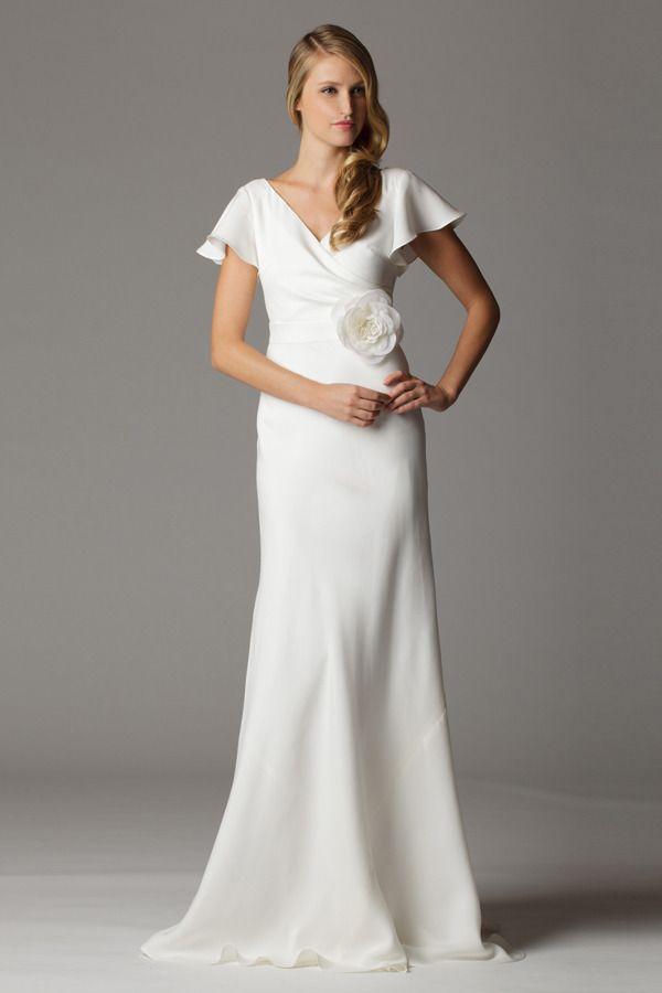 Flutter sleeves surplice neckline wedding dress with built in waistband.